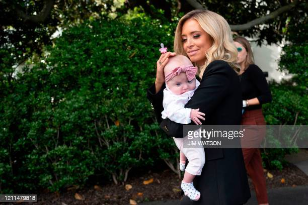 White House Press Secretary Kayleigh McEnany walks with her daughter after watching US President Donald Trump depart the White House in Washington DC...