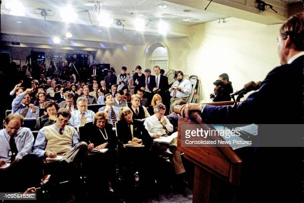 White House Press Secretary Mike McCurry delivers a daily briefing in the White House's Press Room, Washington DC, November 13, 1995. Among the...