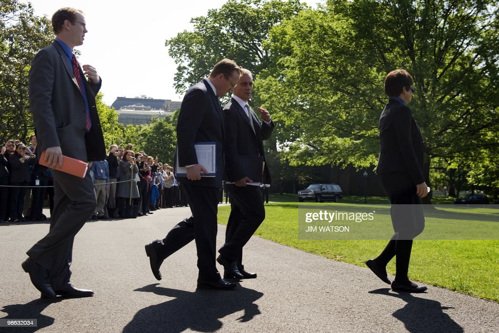White House Press Secretary Robert Gibbs (2nd L) speaks with White House chief of Staff Rahm Emanuel (C) as they follow US President Barack Obama (not pictured) out to Marine One at the White House in Washington, DC, April 21, 2010, as he prepares to leave for New York City. Senior Advisor Valerie Jarrett (R) is also pictured. AFP PHOTO/Jim WATSON