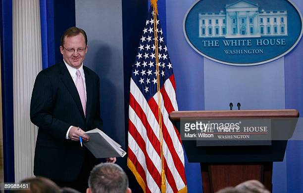 White House Press Secretary Robert Gibbs walks up to the podium during a press briefing at the White House on August 21 2009 in Washington DC Later...