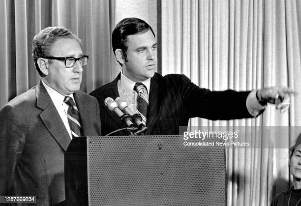 White House Press Secretary Ron Ziegler calls on a reporter as United States National Security Advisor Henry A Kissinger briefs reporters on his trip...