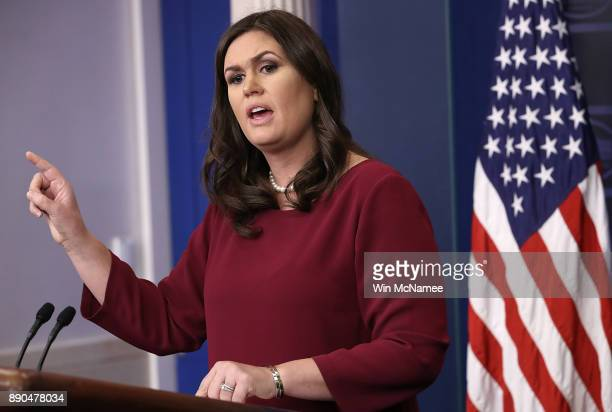 White House press secretary Sarah Huckabee Sanders answers a question during the daily briefing at the White House December 11 2017 in Washington DC...