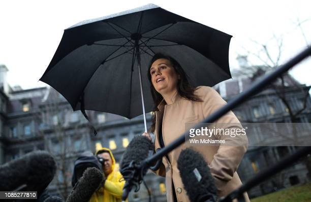 White House Press Secretary Sarah Huckabee Sanders answers questions outside the West Wing of the White House on December 21 2018 in Washington DC...