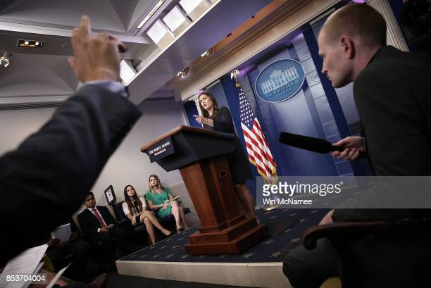 White House Press Secretary Sarah Huckabee Sanders answers questions during a briefing at the White House September 25 2017 in Washington DC Sanders...