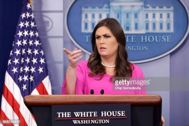 White House Press Secretary Sarah Huckabee Sanders answers reporters' questions during a news conference in the Brady Press Briefing Room at the...