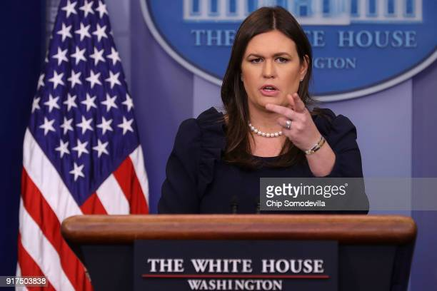 White House Press Secretary Sarah Huckabee Sanders calls on reporters during a press briefing at the White House February 12 2018 in Washington DC...