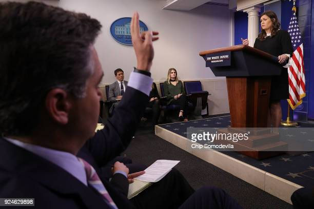 White House Press Secretary Sarah Huckabee Sanders calls on reporters during a news briefing at the White House February 26 2018 in Washington DC...