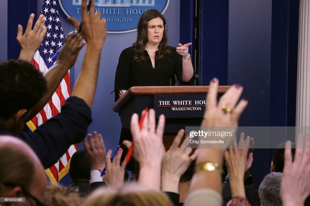 White House Press Secretary Sarah Huckabee Sanders calls on reporters during a news conference in the Brady Press Briefing Room at the White House March 12, 2018 in Washington, DC. Sanders faced many questions about President Donald Trump's school safety proposal which includes 'hardening' schools, strengthening background checks for gun purchases and mental health program reform but does not include raising the age from 18 to 21 for gun purchases.