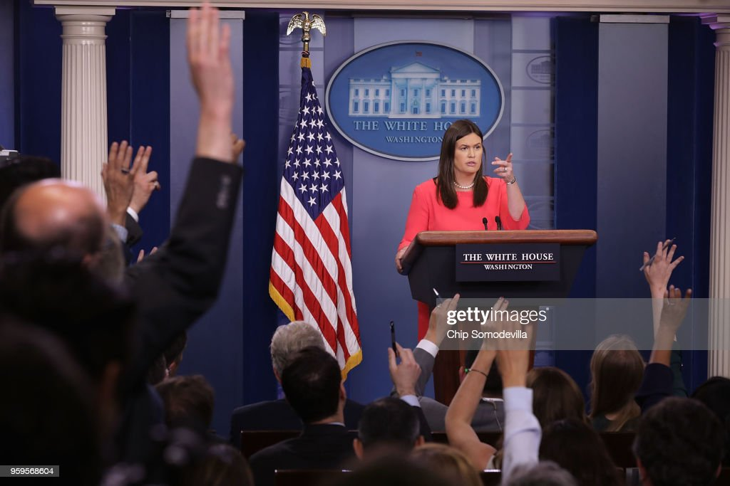White House Press Secretary Sarah Huckabee Sanders calls on reporters during the daily news conference in the Brady Press Briefing Room at the White House May 17, 2018 in Washington, DC. Sanders faced questions about Michael Cohen, upcoming talks with North Korea, why the president called some immigrants non-people and animals and other inquiries.
