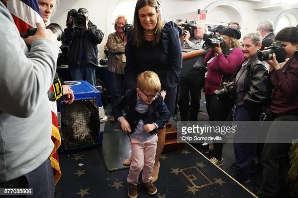 White House Press Secretary Sarah Huckabee Sanders carries her son fouryearold Huck while previewing the Thanksgiving turkey in the Brady Press...