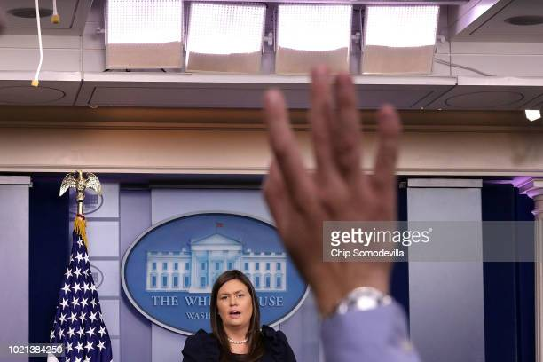 White House Press Secretary Sarah Huckabee Sanders conducts a news conference in the Brady Press Briefing Room at the White House August 22, 2018 in...