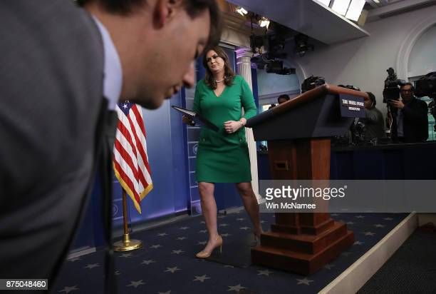 White House press secretary Sarah Huckabee Sanders departs after answering questions during a briefing at the White House on November 16 2017 in...