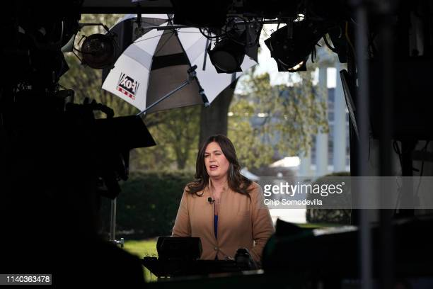 White House Press Secretary Sarah Huckabee Sanders is interviewed by FOX News outside the West Wing of the White House April 04 2019 in Washington DC...