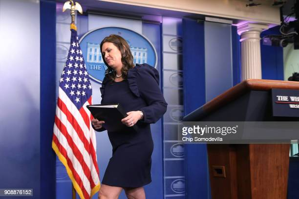 White House Press Secretary Sarah Huckabee Sanders leaves after a news conference in the Brady Press Briefing Room at the White House January 22 2018...