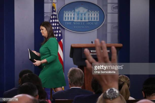 White House Press Secretary Sarah Huckabee Sanders leaves the podium at the conclusion of a news conference the Brady Press Briefing Room at the...