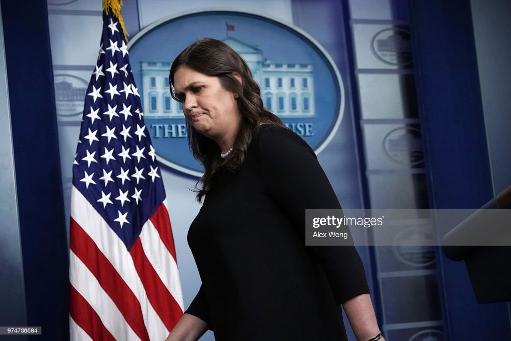 White House Press Secretary Sarah Huckabee Sanders leaves the podium after a White House daily news briefing at the James Brady Press Briefing Room of the White House June 14, 2018 in Washington, DC.
