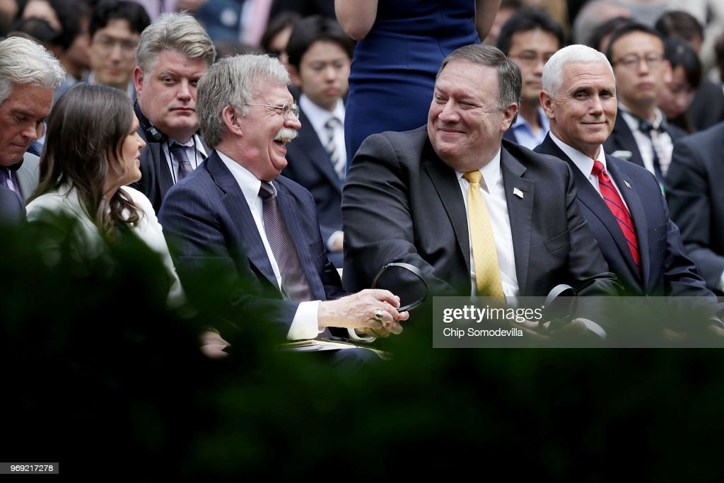 White House Press Secretary Sarah Huckabee Sanders, National Security Advisor John Bolton, U.S. Secretary of State Mike Pompeo and Vice President Mike Pence share a laugh before the start of a joint news conference with President Donald Trump and Japanese Prime Minister Shinzo Abe in the Rose Garden at the White House June 7, 2018 in Washington, DC. Trump and Abe discussed the upcoming U.S.-North Korea summit.