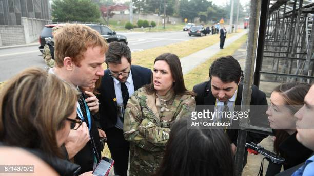 White House press secretary Sarah Huckabee Sanders speaks to reporters after presidential helicopters returned US President Donald Trump to US Army...