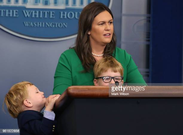 White House Press Secretary Sarah Huckabee Sanders stands with her two sons William and George while taking questions from children during Take Your...