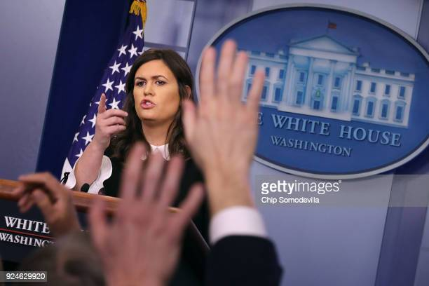 White House Press Secretary Sarah Huckabee Sanders takes questions from reporters during a news briefing at the White House February 26 2018 in...