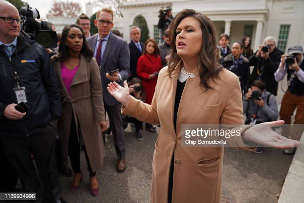 White House Press Secretary Sarah Huckabee Sanders talks to journalists outside the West Wing of the White House April 02 2019 in Washington DC...
