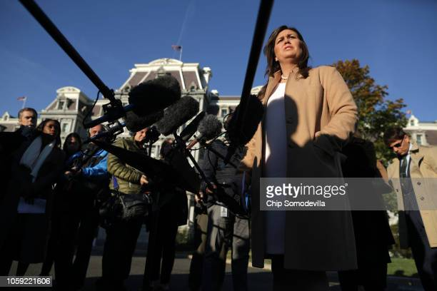 White House Press Secretary Sarah Huckabee Sanders talks to reporters following an interview with FOX News outside the West Wing at the White House...