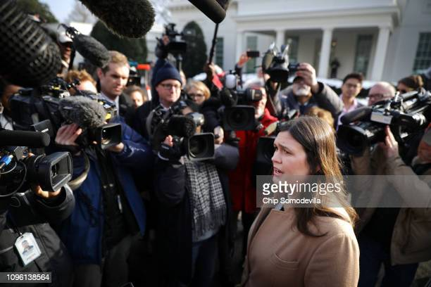 White House Press Secretary Sarah Huckabee Sanders talks to reporters outside the West Wing of the White House January 18 2019 in Washington DC...