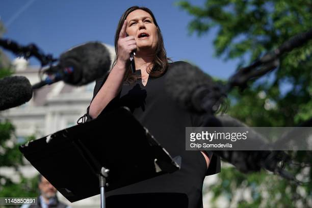 White House Press Secretary Sarah Huckabee Sanders talks to reporters after being interviewed on FOX News outside the White House April 29 2019 in...