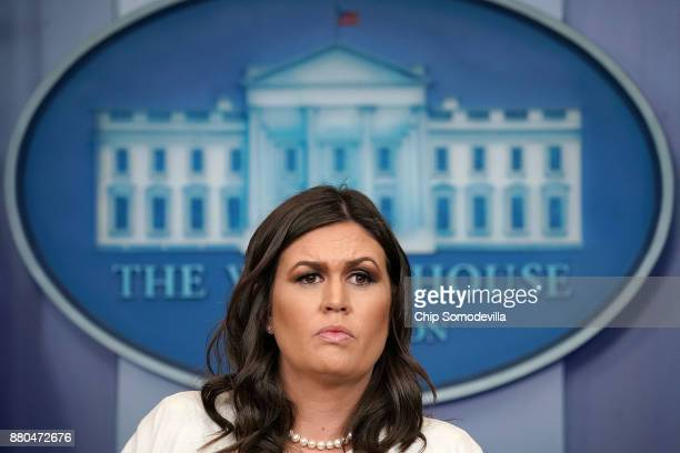 White House Press Secretary Sarah Huckabee Sanders talks with reporters during the daily news conference in the Brady Press Briefing Room at the...