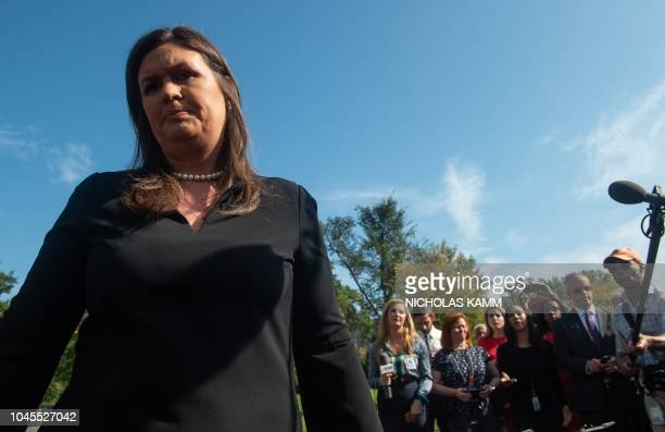 White House Press Secretary Sarah Huckabee Sanders walks away after speaking to the press at the White House in Washington DC on October 4 2018