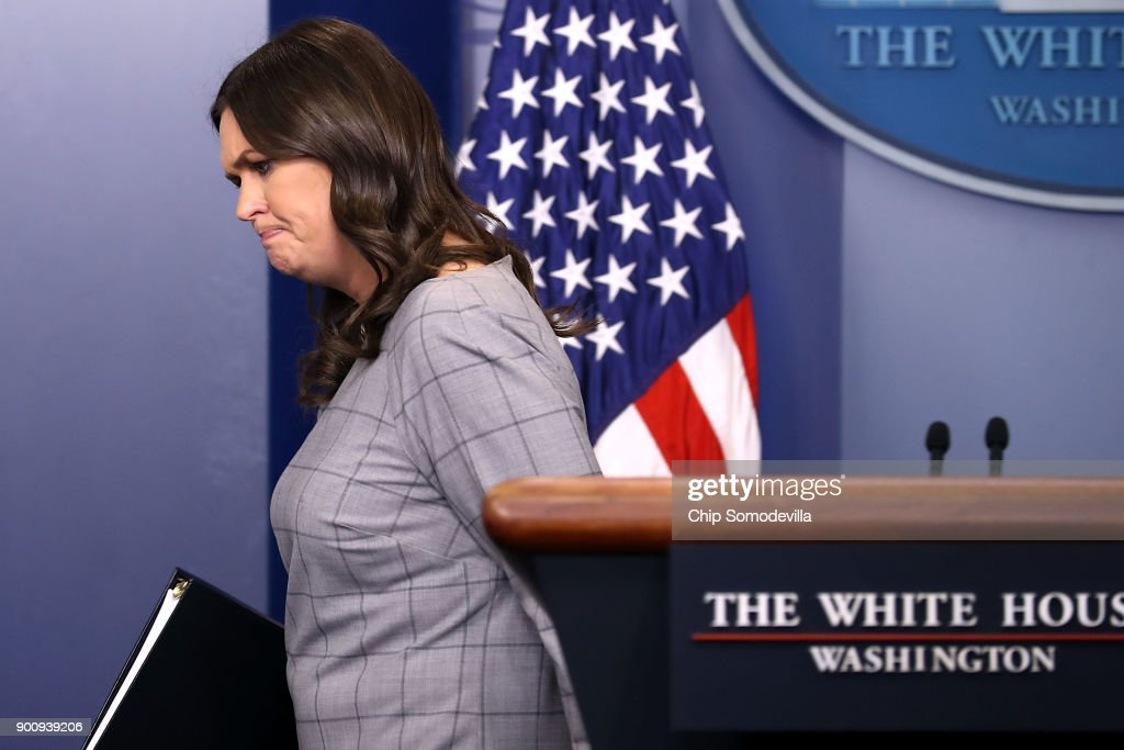 White House Press Secretary Sarah Huckabee Sanders walks off the podium at the conclusion of a news conference in the Brady Press Briefing Room at the White House January 3, 2018 in Washington, DC. Sanders took questions from many reporters about President Donald Trump's statement about former White House Senior Advisor Steve Bannon, in which he said 'When he was fired, he not only lost his job, he lost his mind.'