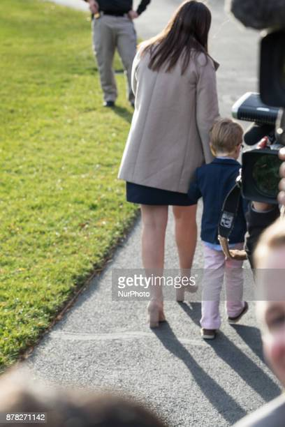White House Press Secretary Sarah Sanders and her 4 1/2yearold son Huck leave the South Lawn of the White House in Washington DC before the departure...