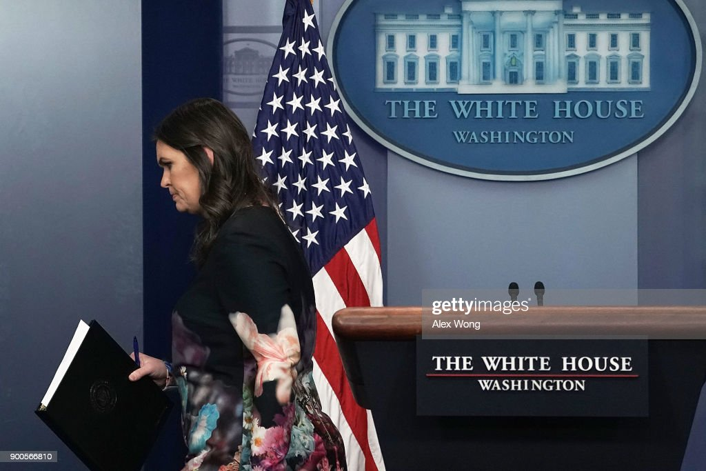 White House Press Secretary Sarah Sanders leaves after a daily news briefing at the James Brady Press Briefing of the White House January 2, 2018 in Washington, DC. Sanders filled questions from members of the media in her first daily briefing of the year.