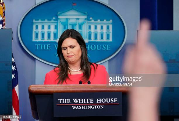 TOPSHOT White House Press Secretary Sarah Sanders looks on during a briefing in the Brady Briefing Room of the White House in Washington DC on...