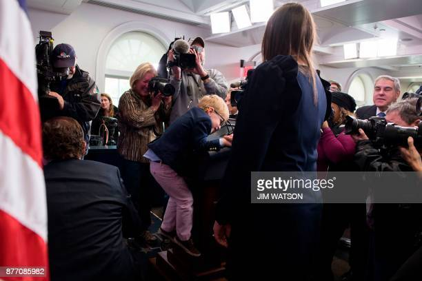 White House Press Secretary Sarah Sanders' son Huck climbs up on the lectern as the press gets a sneak peak at the tobepardoned Thanksgiving turkey...