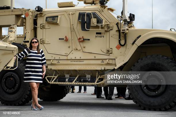White House Press Secretary Sarah Sanders waits as US President Donald Trump watches an air assault exercise at Fort Drum New York on August 13 2018
