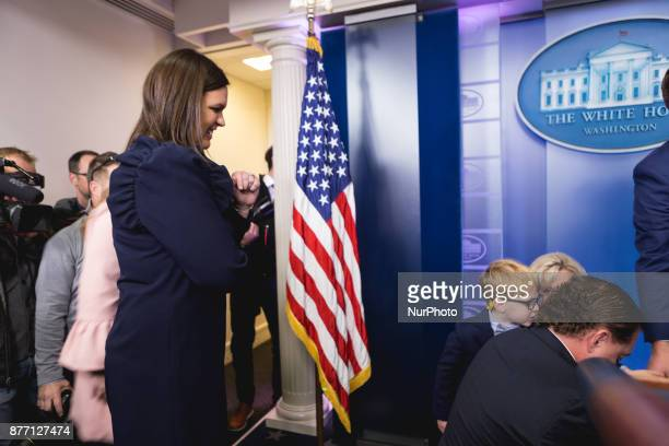 White House Press Secretary Sarah Sanders watches her 4 1/2yearold son Huck help Wishbone back in his crate Wishbone is one of the turkeys who may be...