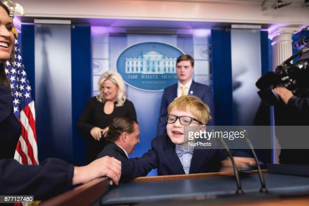 White House Press Secretary Sarah Sanders watches her 4 1/2yearold son Huck climb up to the podium in the James S Brady Press Briefing Room of the...