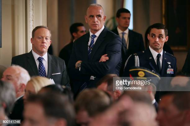 White House Press Secretary Sean Spicer and White House Director of Oval Office Operations Keith Schiller arrive for a signing ceremony for the...