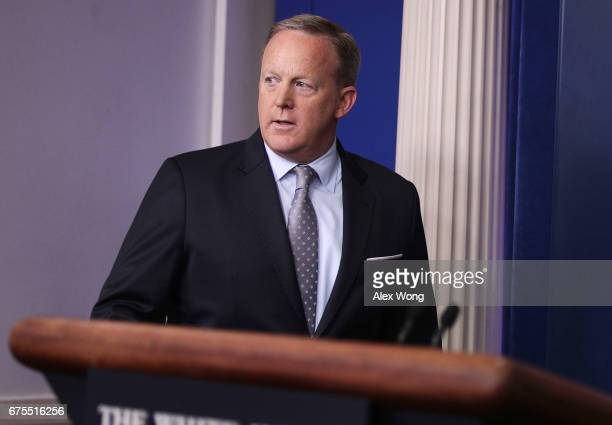 White House Press Secretary Sean Spicer approaches the podium for a daily news briefing at the James Brady Press Briefing Room of the White House May...