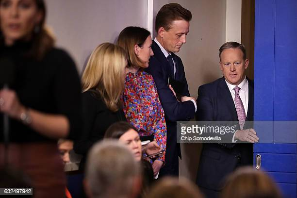 White House Press Secretary Sean Spicer arrives for the daily press briefing as Deputy Assistant to the President Sean Cairncross and Deputy Press...