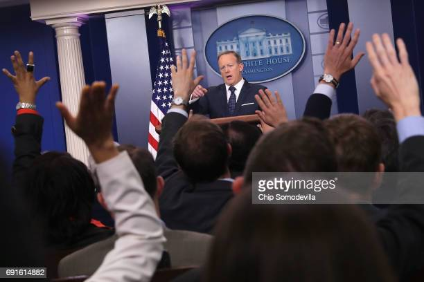 White House Press Secretary Sean Spicer calls on reporters during a briefing at the White House June 2 2017 in Washington DC Neither Spicer nor EPA...