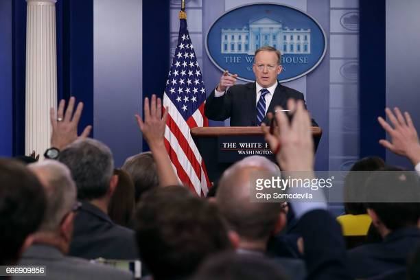 White House Press Secretary Sean Spicer calls on reporters during the daily news conference in the Brady Press Briefing Room at the White House April...