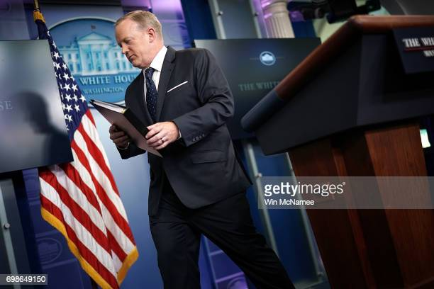 White House press secretary Sean Spicer departs after a briefing at the White House June 20 2017 in Washington DC Spicer answered a range of...