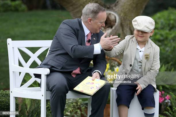 White House Press Secretary Sean Spicer gives a highfive to a boy who sat next to him while he read the childrens' book 'How To Catch The Easter...