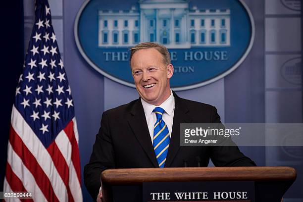 White House Press Secretary Sean Spicer laughs during the daily press briefing in the James Brady Press Briefing Room at the White House January 24...