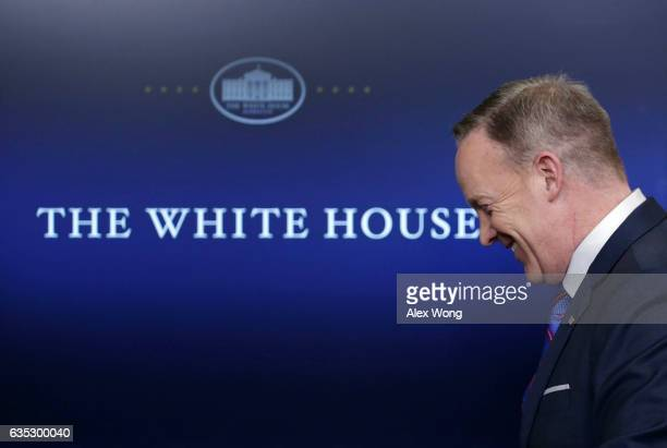 White House Press Secretary Sean Spicer leaves after a daily press briefing at the James Brady Press Briefing Room February 14, 2017 at the White...