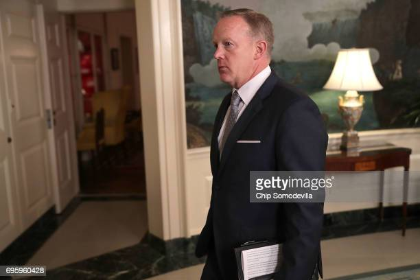 White House Press Secretary Sean Spicer leaves the Diplomatic Room following a statement by US President Donald Trump concerning the morning shooting...