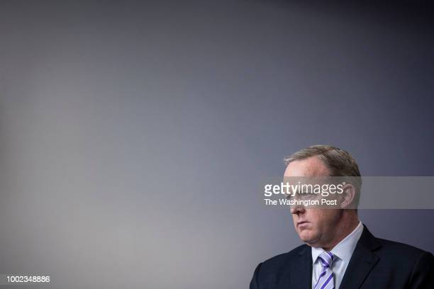 White House press secretary Sean Spicer listens as National Security Adviser HR McMaster speaks during a briefing in the James S Brady of the White...