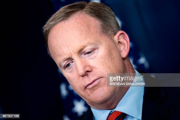 White House Press Secretary Sean Spicer listens to a question during a briefing at the White House April 11 2017 in Washington DC / AFP PHOTO /...